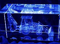 Szklana statuetka z koparko-ładowarką 3d