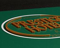 Szyld reklamowy dla fundacji, wypukłe złote litery na zielonym tle