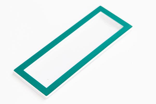 Identyfikator z wymienną etykietą - zielona ramka