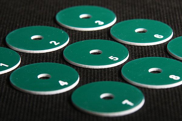 Okrągły zielono biały numerek do szatni