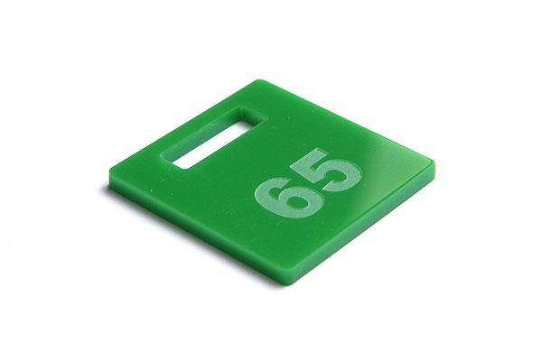 Numerek do szatni lub do kluczy na zielonej pleksi