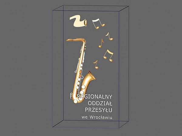 Projekt wizualizacja 3d grawerowania saksofonu w szklanej statuetce - perspektywa